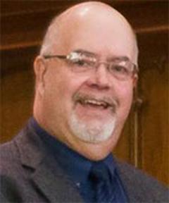 Dr-Thom-Gardner-smiling-with-glasses